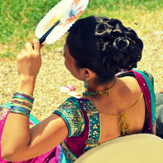"""Indian Woman with Japanese Fan"" stock image"