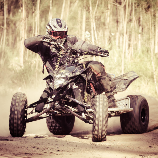 """ATV racer takes a turn during a race."" stock image"
