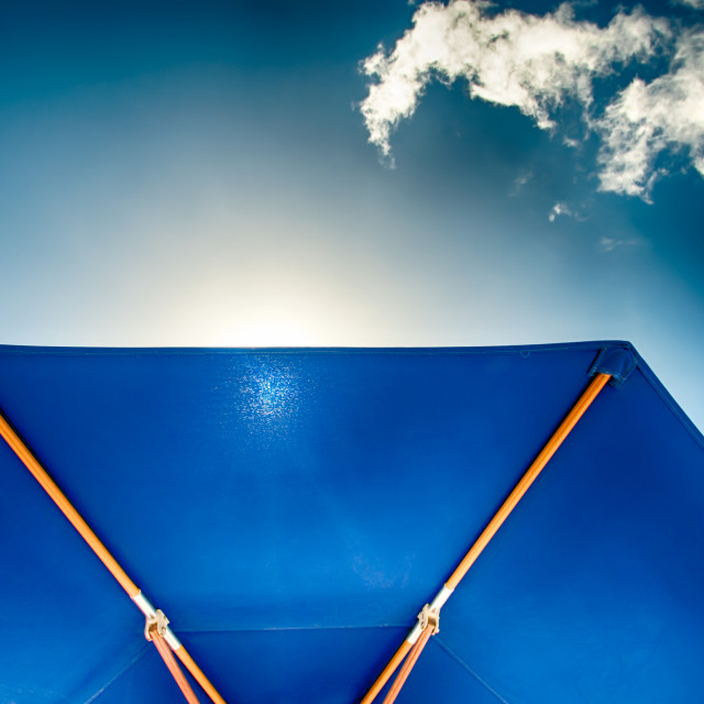 """Blue Sunshade against blue Sky"" stock image"