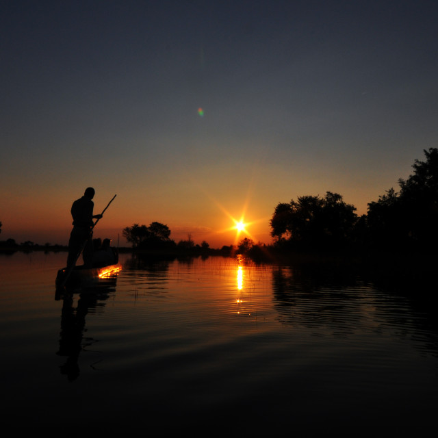 """Sunset on the Okavango"" stock image"