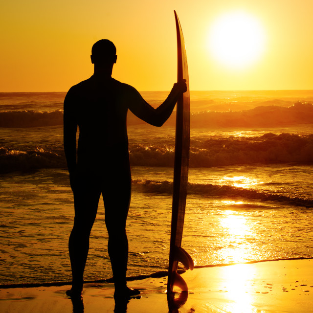 """A surfer watching the waves"" stock image"