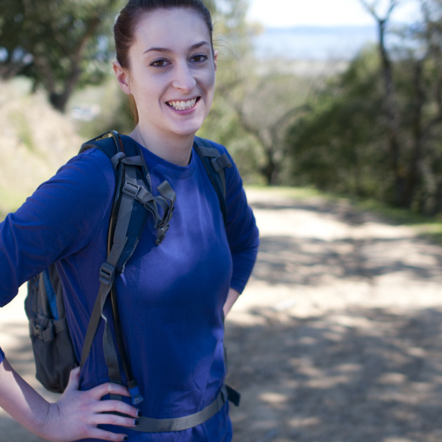 """Hiker woman in blue long sleeve shirt looks at camera"" stock image"