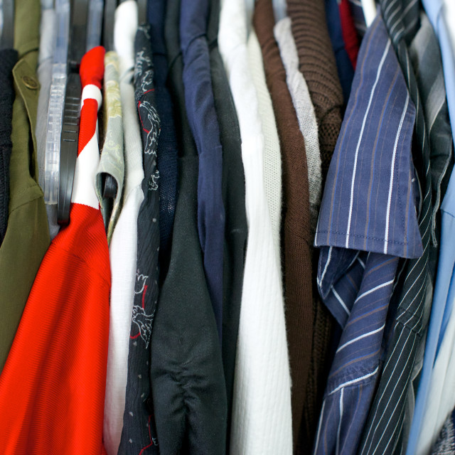 """Close up of clothing, red shirt on left"" stock image"