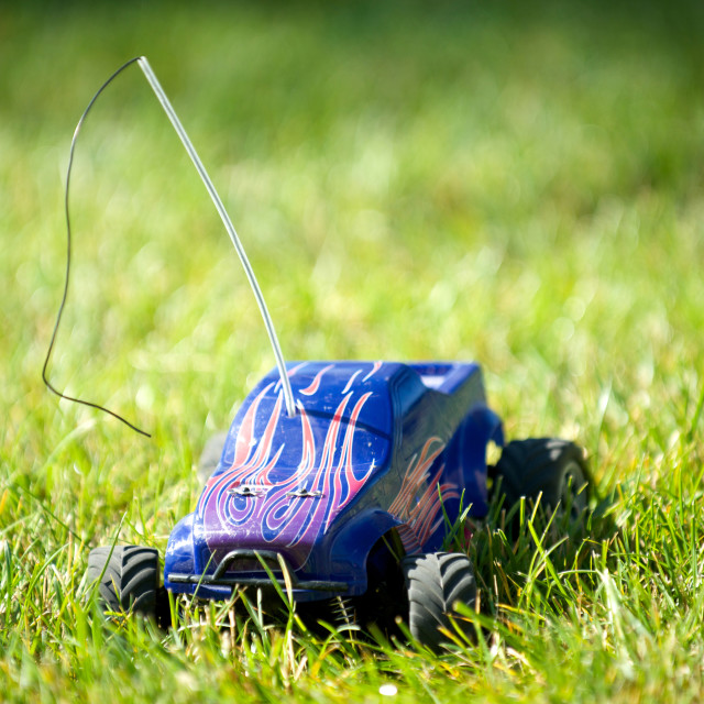 """Horizontal of toy RC truck in grass"" stock image"