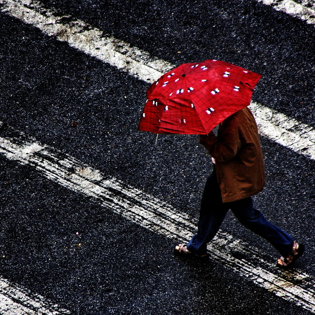 """""""Man with a red umbrella"""" stock image"""