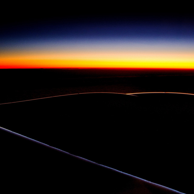 """Sunrise at 35000 feet"" stock image"