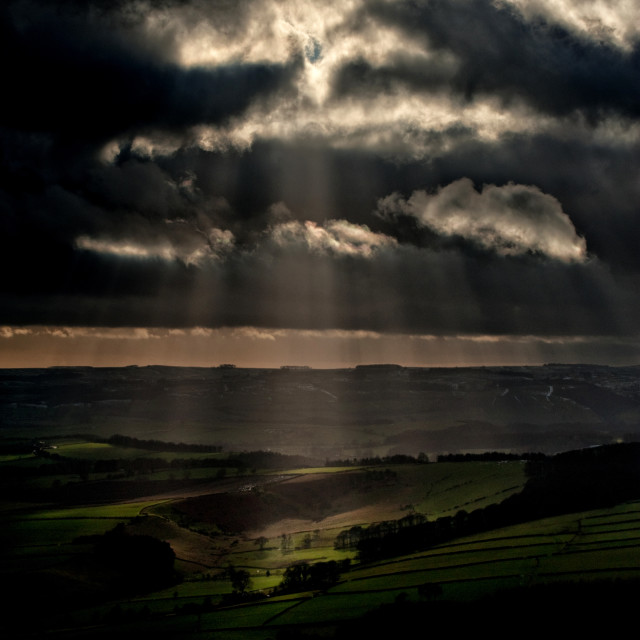 """Sunburst over the Peak District"" stock image"