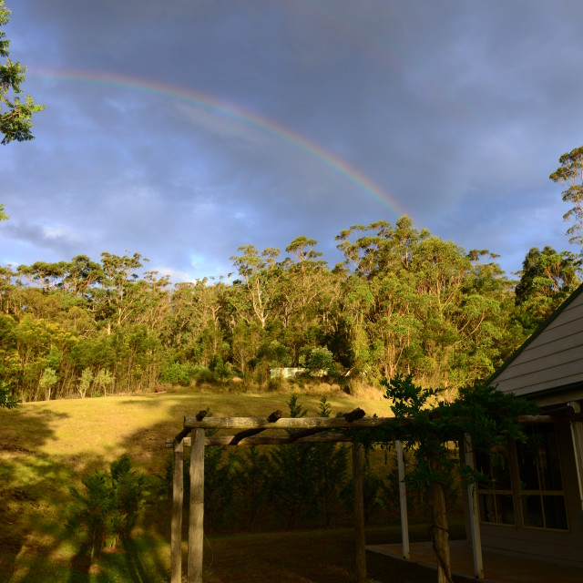"""Rainbow over Kangaroo valley house"" stock image"