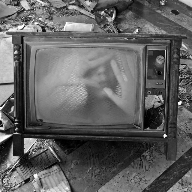 """ghostly figure on vintage tv set"" stock image"