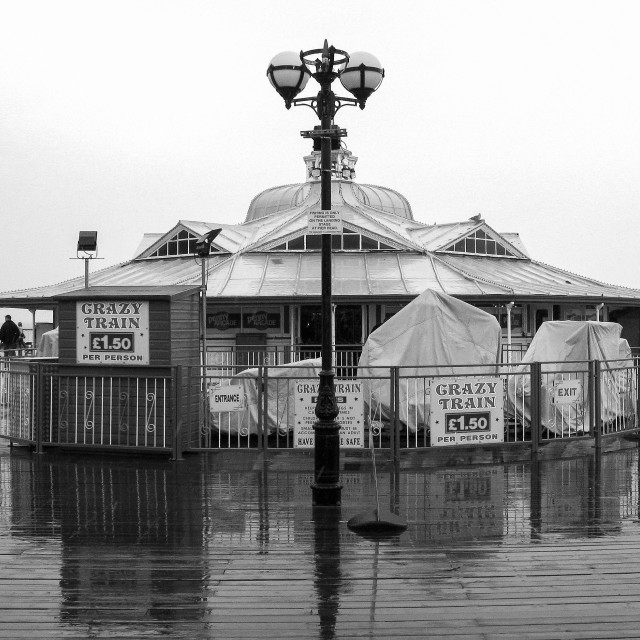 """""""Llandudno pier on a rainy day"""" stock image"""