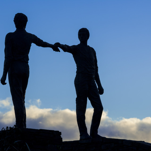 """""""Hands across the divide"""" stock image"""