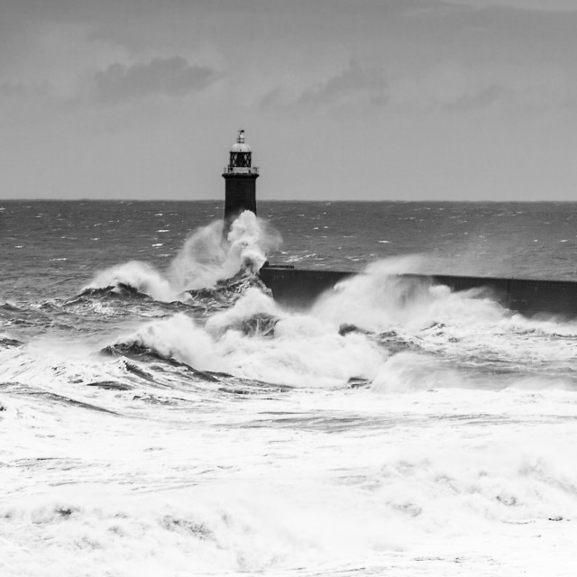 """Lighthouse in stormy sea"" stock image"