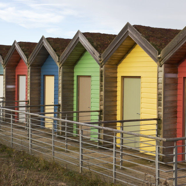 """Colourful beach huts"" stock image"