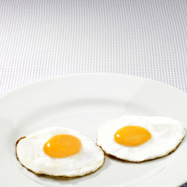 """Two fried eggs"" stock image"