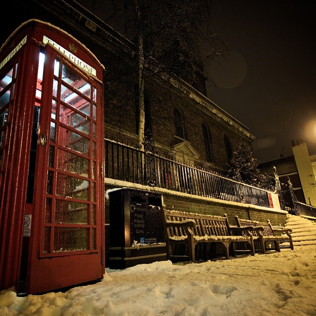 """Phone box in the night time snow"" stock image"