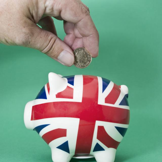 """Saving British pounds"" stock image"