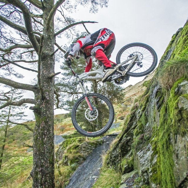 """Flying Downhill Mountain Bike Rider"" stock image"