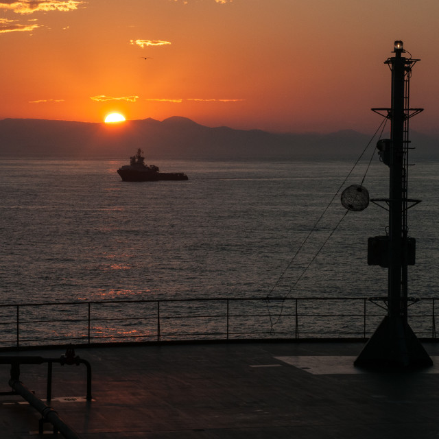 """Sunrise at anchor"" stock image"