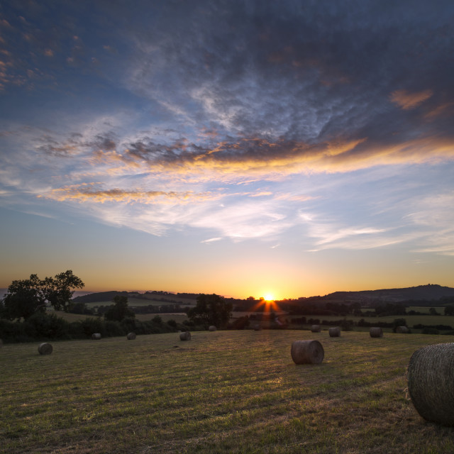 """Sunset over Hay Bales"" stock image"