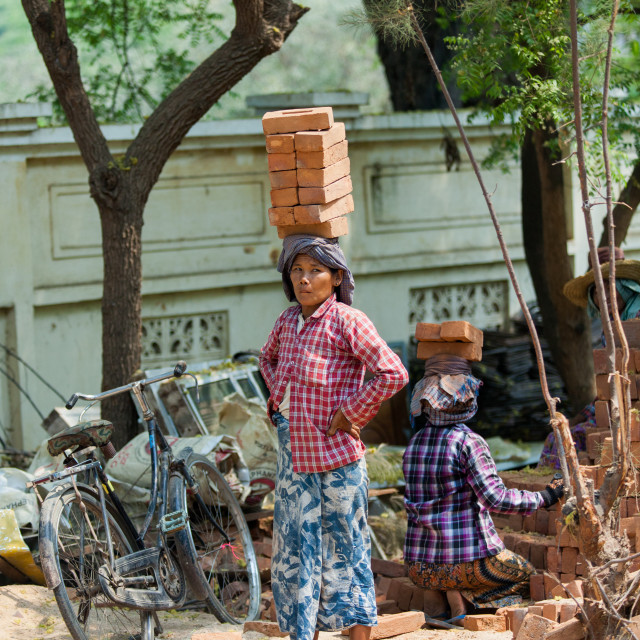 """Women carrying bricks in Myanmar"" stock image"