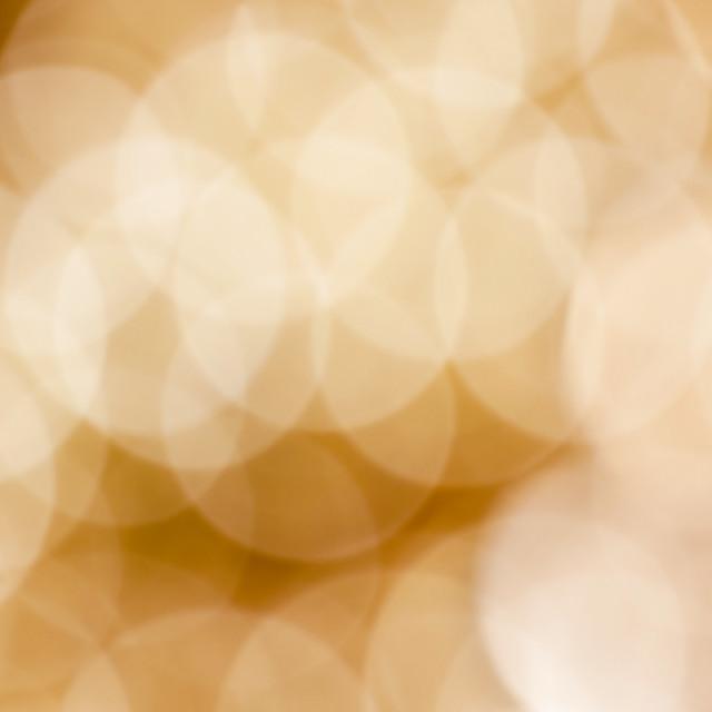 """Bokeh background with defocused golden lights"" stock image"