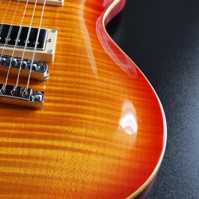 """Cherry sunburst electric guitar"" stock image"