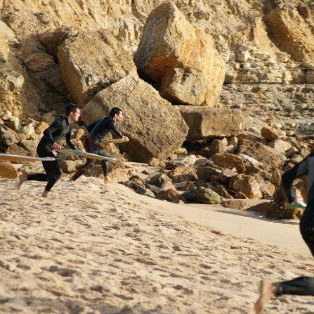 """Skim boarders Running"" stock image"