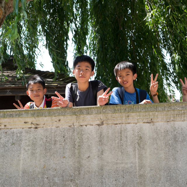 """""""Young Lads Give Peace Salute ."""" stock image"""