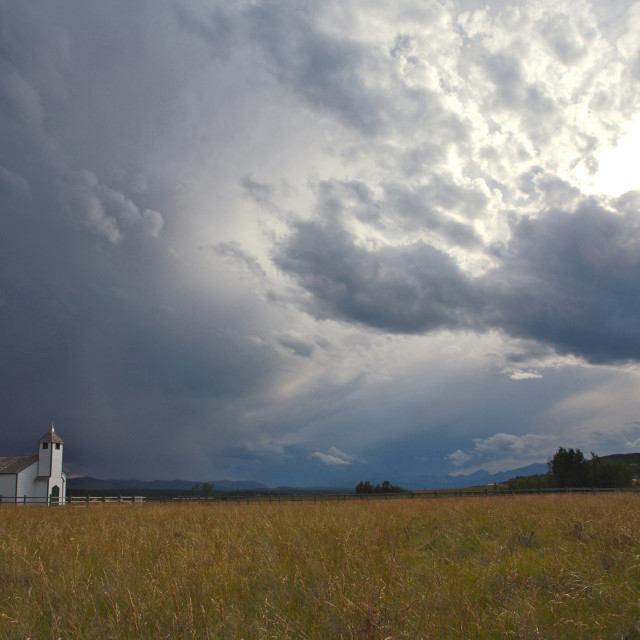 """Country Church with storm clouds"" stock image"