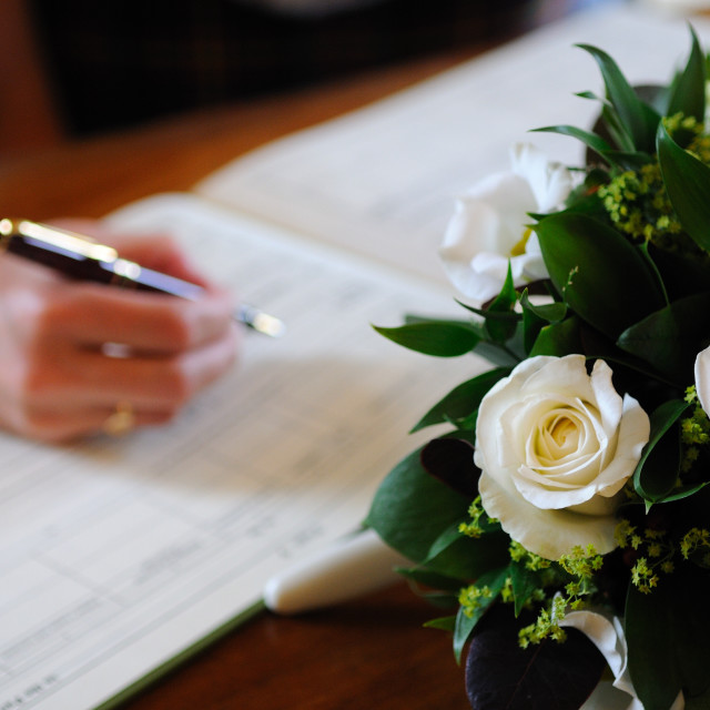 """Signing the wedding register"" stock image"