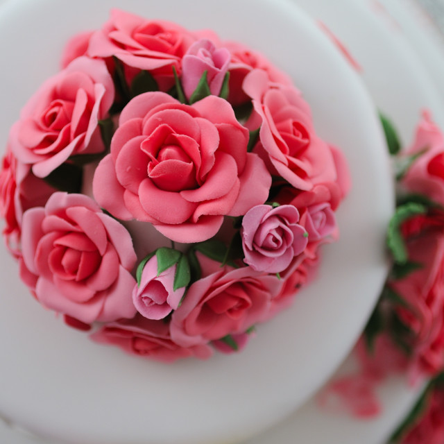 """Wedding cake sugar flowers from above pink"" stock image"