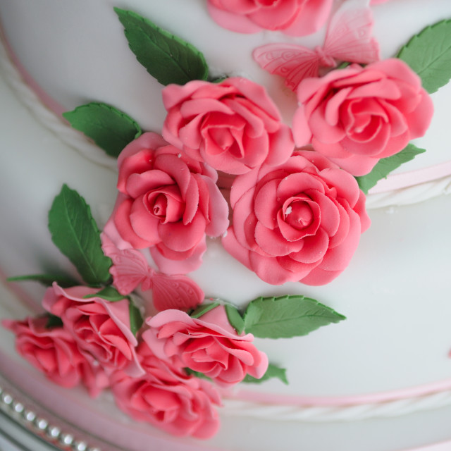 """Wedding cake sugar flowers flowing pink"" stock image"