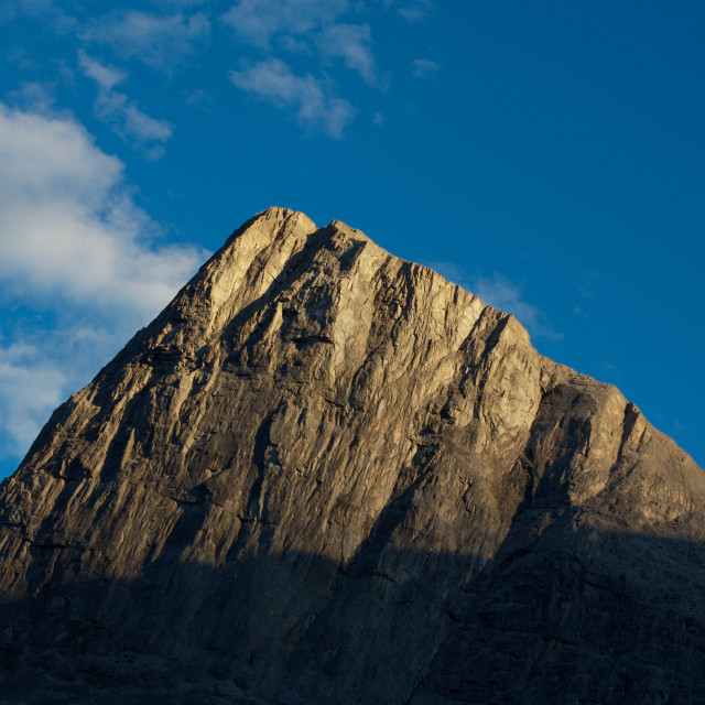 """Evening light on mountain peak"" stock image"