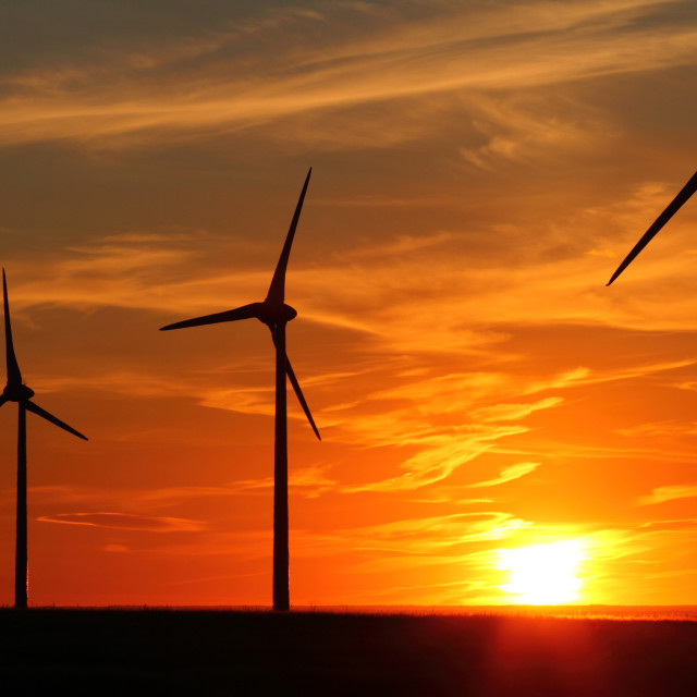 """Wind Turbines at Sunset"" stock image"