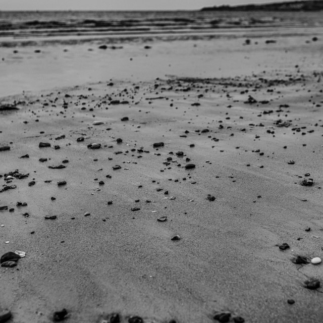 """Pebbled Beach in Swanage, Dorset"" stock image"