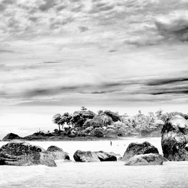"""Boulders at Pandan Beach"" stock image"