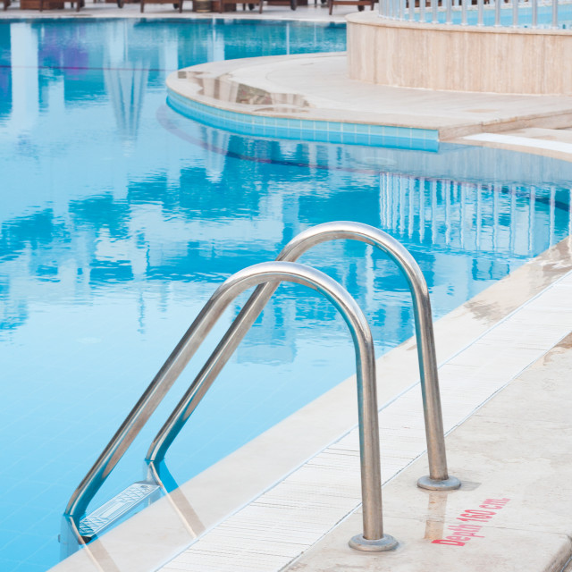 """Ladder and swimming pool closeup"" stock image"
