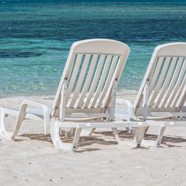 """Sun loungers facing the Caribbean Sea"" stock image"