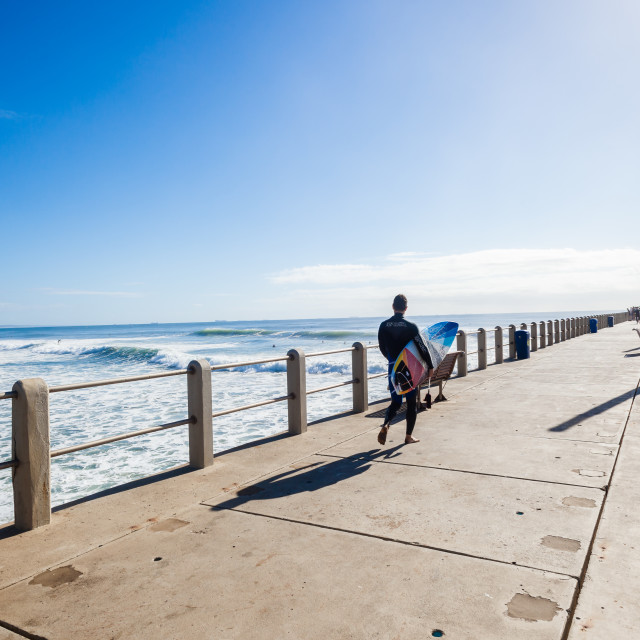 """Surfer Walking Pier Ocean Waves"" stock image"