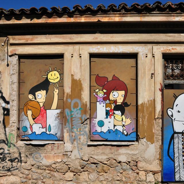 """happy graffiti boarded up windows"" stock image"