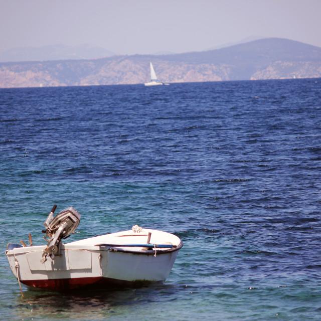 """Boat in Sheltered Bay"" stock image"