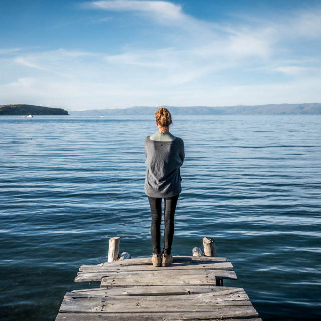 """Woman looking over Lake Titicaca"" stock image"