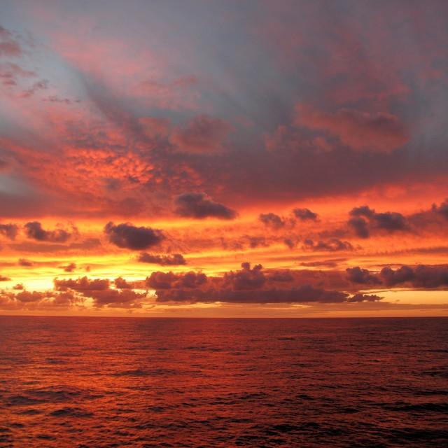 """Fiery sunset at sea (version 1)"" stock image"