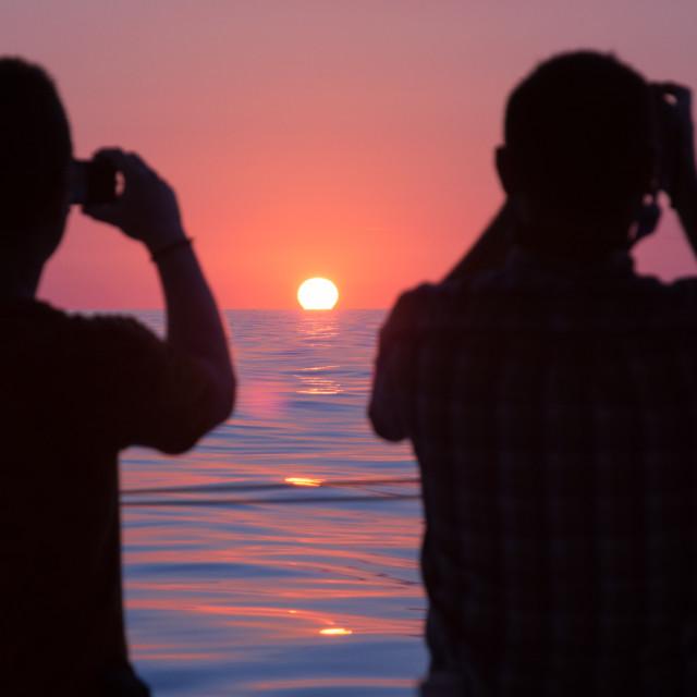 """""""Photographing sunrise"""" stock image"""