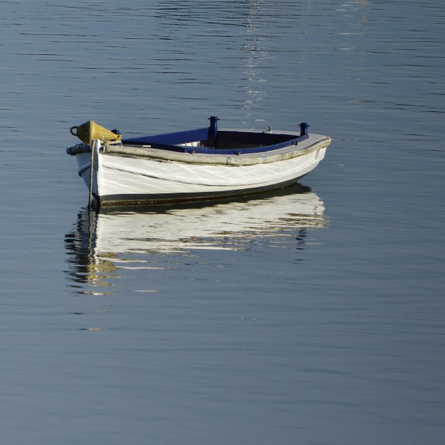 """Dingy In The Bay"" stock image"