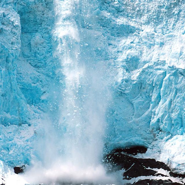 """""""Holgate Glacier calving as kayakers watch in Alaska at Kenai Fjo"""" stock image"""
