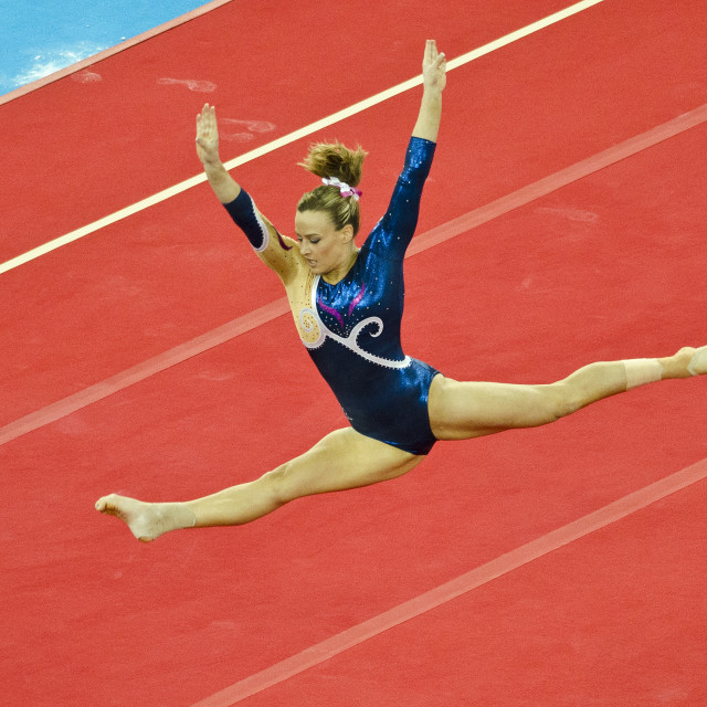 """Emma White on floor in ladies all-around final at Glasgow 2014 Commonwealth Games"" stock image"