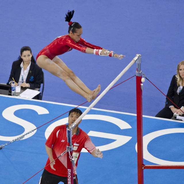 """Gymnast in ladies all-around final at Glasgow 2014 Commonwealth Games"" stock image"