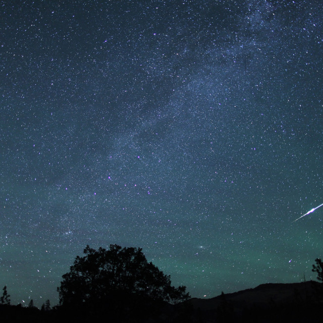 """Meteor fireball streaks through the sky"" stock image"