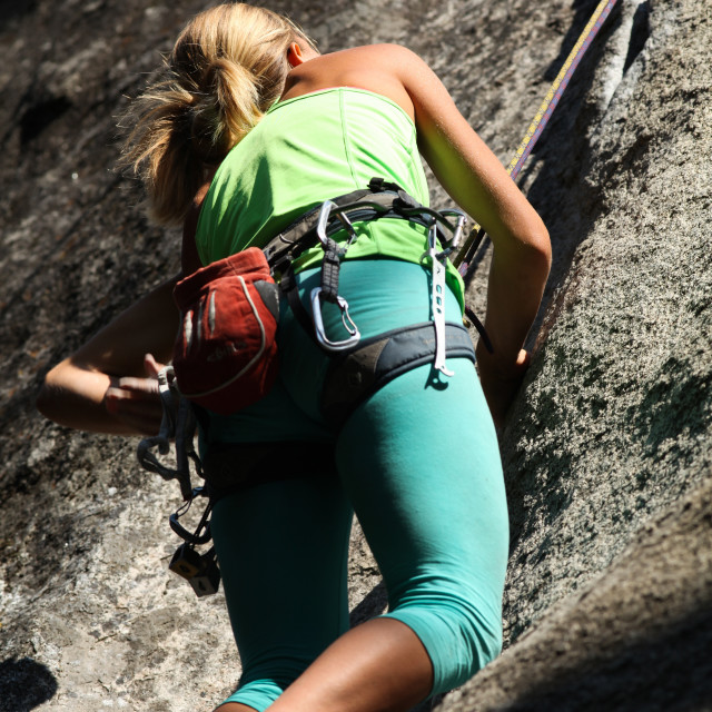 """Lady rock climber ascends granite wall MR MRA by David Hoffmann,"" stock image"